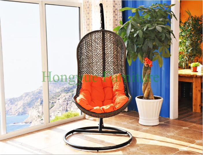 Brown rattan hammock with orange color cushions supplier