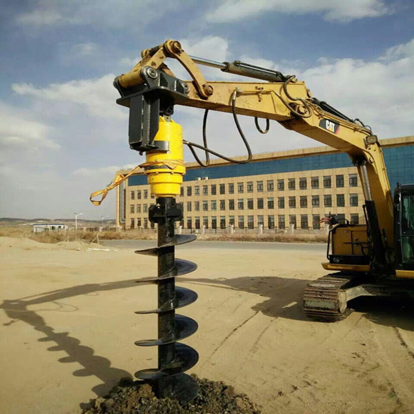 Hydraulic earth auger drive unit mounted on excavator for hole digging or screw piling project