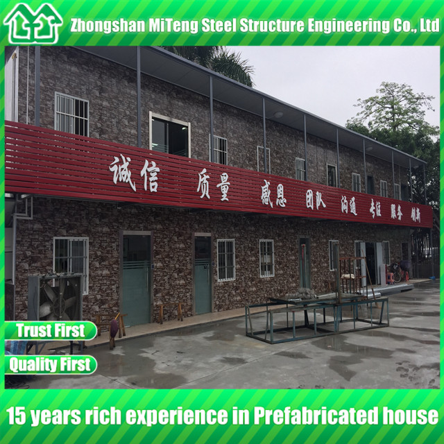 Luxury low cost prefab home steel building with cultural stone sandwich panel