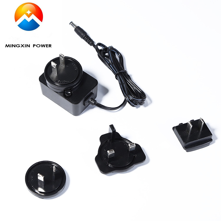 12V1A Universal AC 100 240V to DC Power Adapter with interchangeable US EU AU UK plugs