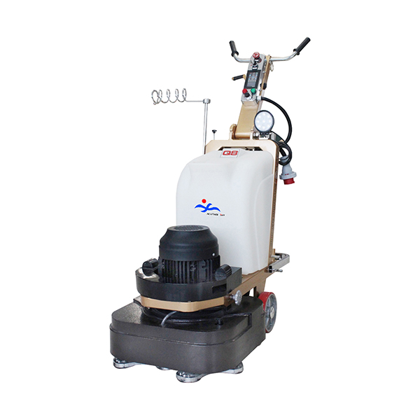Grinding machine for concrete floor