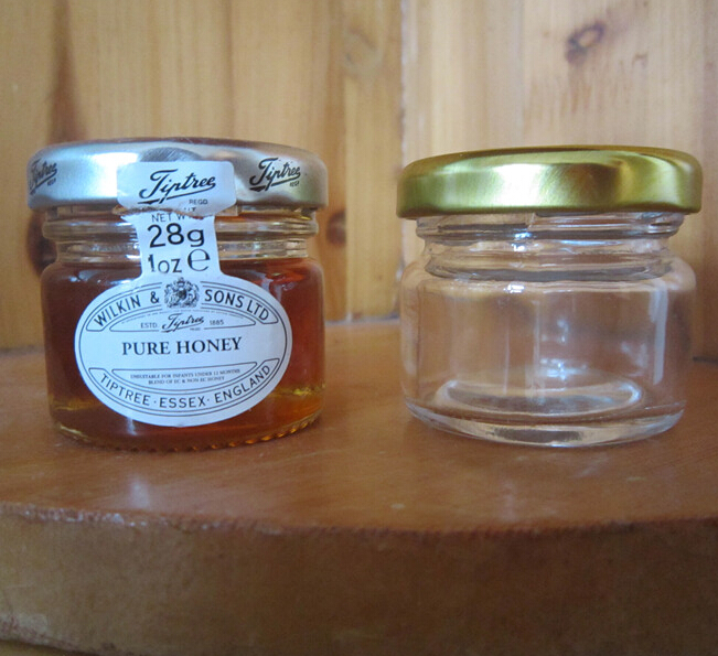 5932499be7fe wholesale small round clear honey glass jars with tin lids 30ml