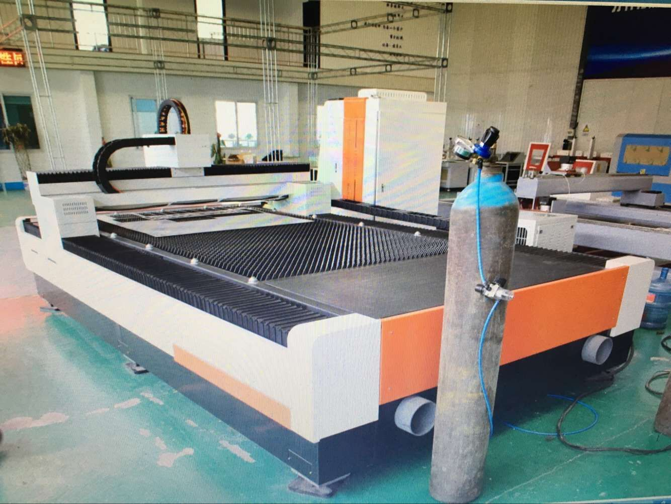 1325 1530 fiber laser cutting machine carding filling machine for metal